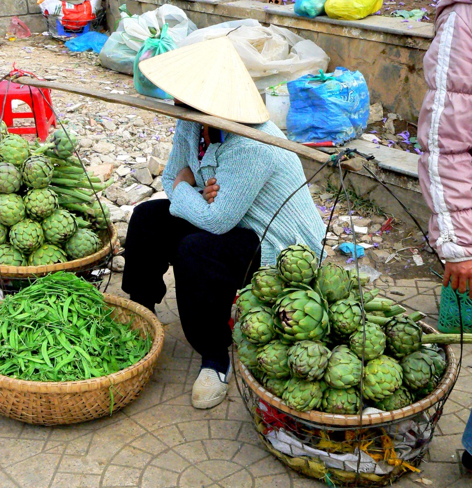 artichoke vendor on a stick